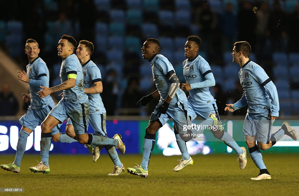 Kean Bryan and the rest of the Manchester City team celebrates winning on a penalty shoot out during the UEFA Youth League Round of 16 match between Manchester City FC and FC Schalke 04 at City Football Academy on February 24, 2015 in Manchester, England.