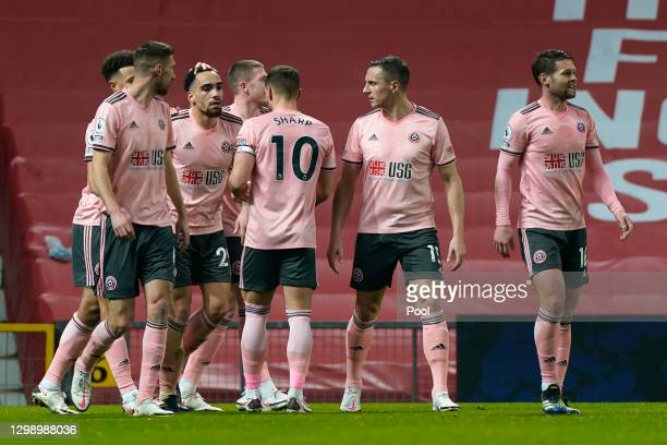 Kean Bryan of Sheffield United celebrates with Chris Basham, Phil Jagielka, Ollie Norwood and team mates after scoring their side's first goal during...