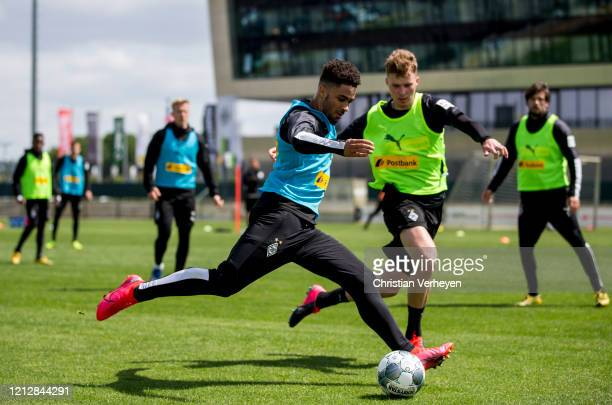Keanan Bennetts and Nico Elvedi of Borussia Moenchengladbach in action during a training session of Borussia Moenchengladbach at BorussiaPark on May...