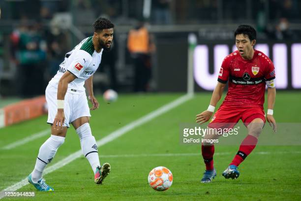 Keanan Bennetts of Borussia Moenchengladbach and Wataru Endo of VfB Stuttgart battle for the ball during the Bundesliga match between Borussia...