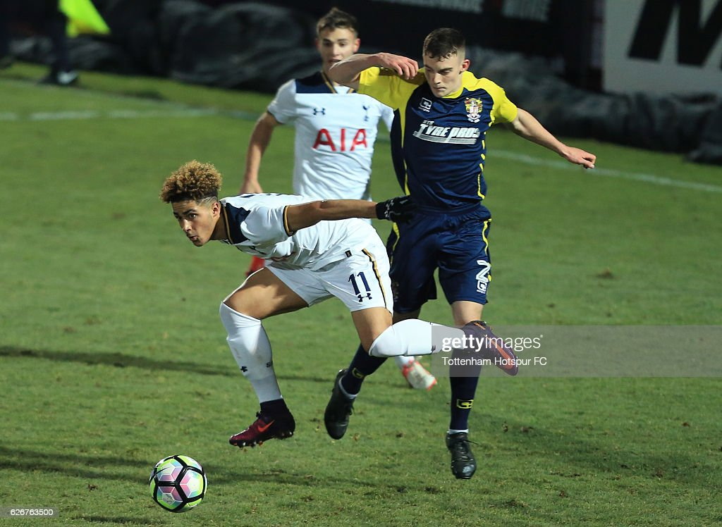 Keanan Bennetts of Tottenham Hotspur holds off the challenge of Macsen Fraser of Stevenage during the FA Youth Cup Third Round between Tottenham Hotspur and Stevenage at The Lamex Stadium on November 30, 2016 in Stevenage, England.