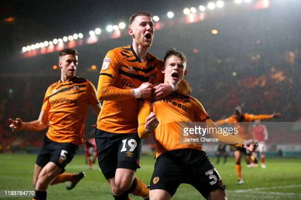 Keane Lewis-Potter of Hull City celebrates after scoring his team's second goal with Josh Bowler and Reece Burke during the Sky Bet Championship...