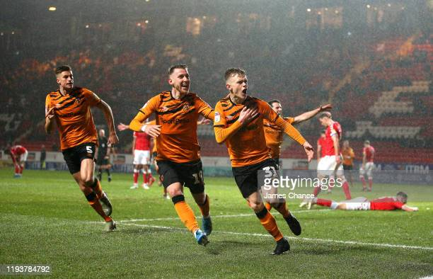 Keane LewisPotter of Hull City celebrates after scoring his team's second goal with Josh Bowler and Reece Burke during the Sky Bet Championship match...