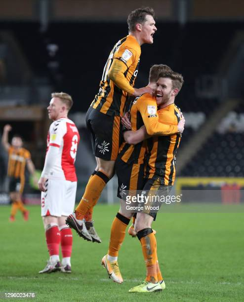 Keane Lewis-Potter of Hull City celebrates with Sean McLoughlin and Callum Elder after scoring their team's second goal during the Papa John's Trophy...
