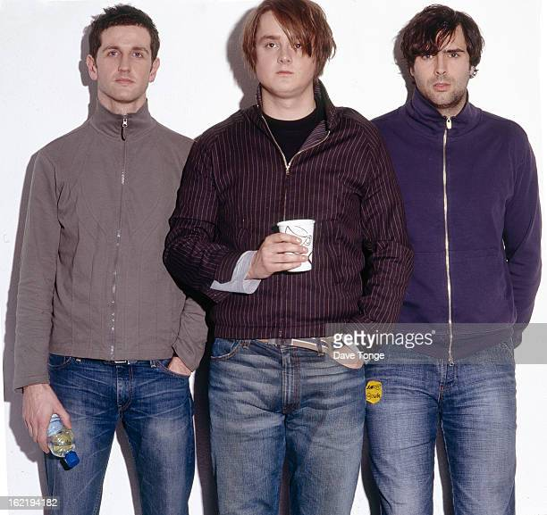 Keane pose for a group portrait backstage at a TV show, London, 2004. L-R Richard Hughes, Tom Chaplin and Tim Rice-Oxley.