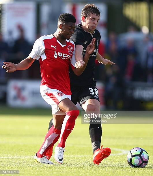 Keano Deacon of Fleetwood Town tackles Jonathan Flanagan of Liverpool during the PreSeason Friendly match between Fleetwood Town and Liverpool at...