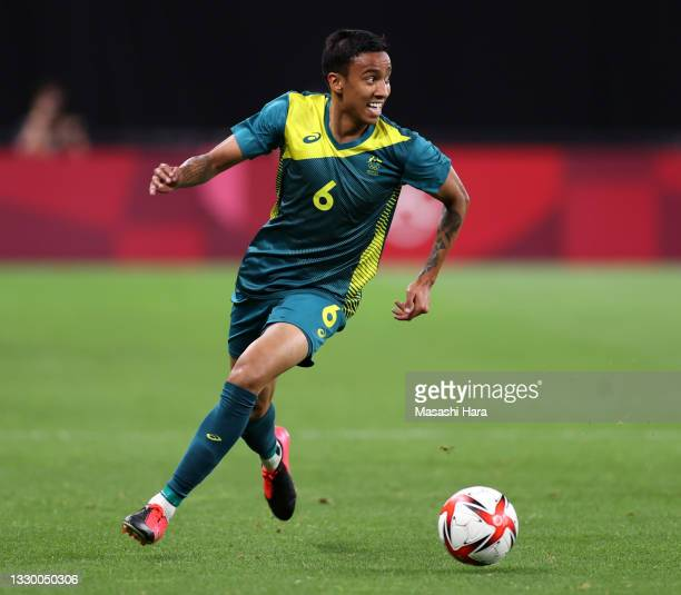 Keanu Baccus of Team Australia in action during the Men's First Round Group C match between Argentina and Australia during the Tokyo 2020 Olympic...
