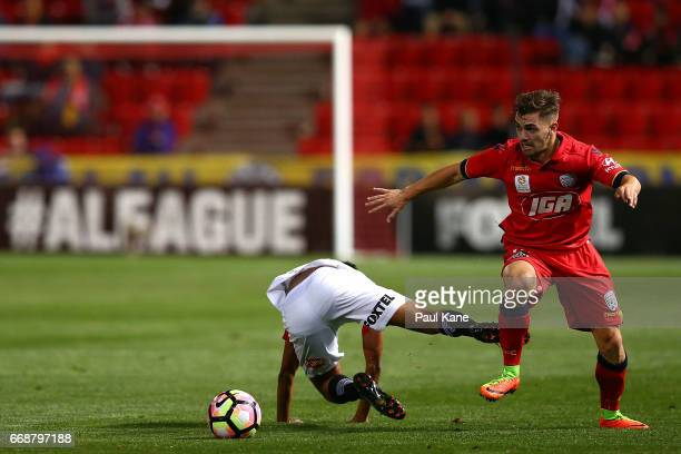 Keanu Baccus of the Wanderers and Ben Garuccio of Adelaide contest for the ball during the round 27 ALeague match between Adelaide United and the...