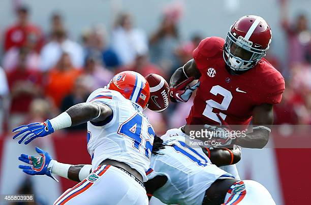 Keanu Neal and Neiron Ball of the Florida Gators force a fumble by DeAndrew White of the Alabama Crimson Tide at BryantDenny Stadium on September 20...