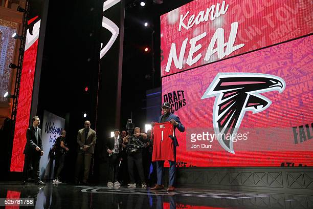 Keanu Neal of Florida holds up a jersey after being picked overall by the Atlanta Falcons during the first round of the 2016 NFL Draft at the...