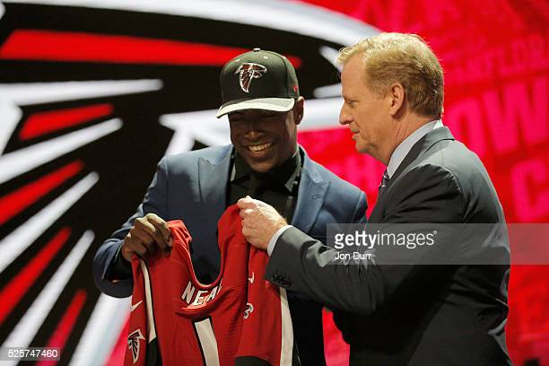 Keanu Neal of Florida holds up a jersey with NFL Commissioner Roger Goodell after being picked overall by the Atlanta Falcons during the first round...
