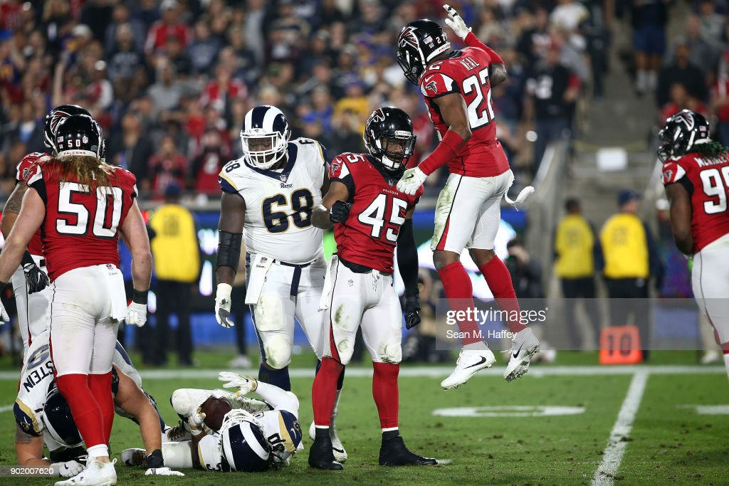 Keanu Neal #22 of the Atlanta Falcons and Deion Jones #45 reacts after tackling Todd Gurley #30 of the Los Angeles Rams during the NFC Wild Card Playoff Game at the Los Angeles Coliseum on January 6, 2018 in Los Angeles, California.