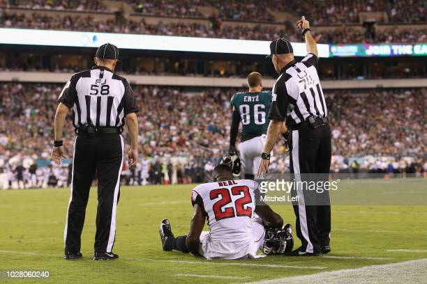 Keanu Neal of the Atlanta Falcons sits on the ground after suffering an apparent injury during the first half against the Philadelphia Eagles at...