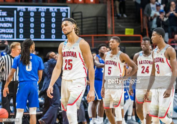 Keanu Pinder of the Arizona Wildcats and team mates leave the court in disbelief during the NCAA Division I Men's Championship First Round game...