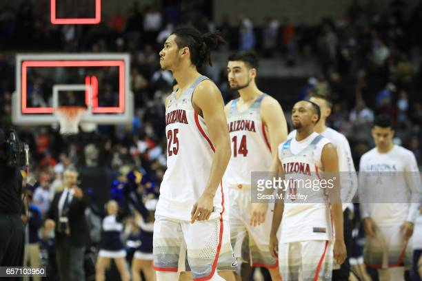 Keanu Pinder of the Arizona Wildcats and teammates react to their 71 to 73 loss to the Xavier Musketeers during the 2017 NCAA Men's Basketball...