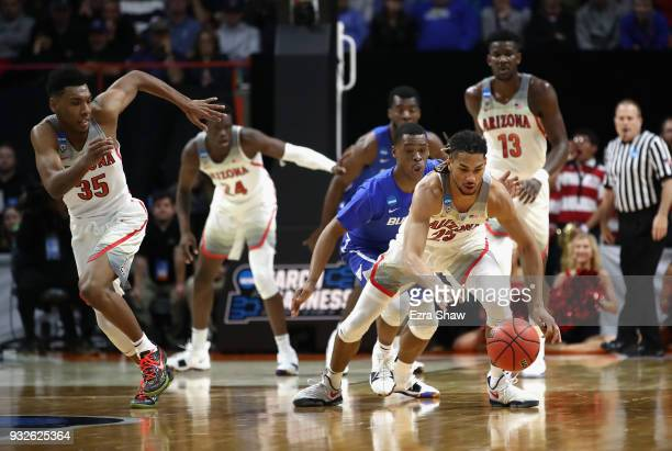 Keanu Pinder of the Arizona Wildcats attempts to handle the ball against the Buffalo Bulls during the first round of the 2018 NCAA Men's Basketball...