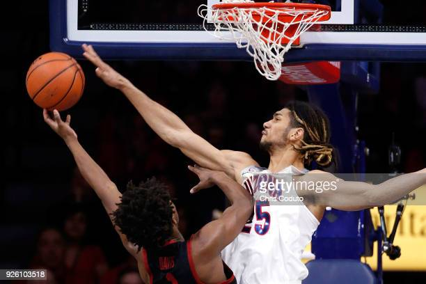 Keanu Pinder of the Arizona Wildcats blocks a shot by Daejon Davis of the Stanford Cardinal during the first half of the college basketball game at...