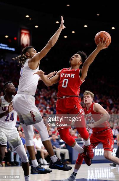 Keanu Pinder of the Arizona Wildcats defends Sedrick Barefield of the Utah Utes during the first half of the college basketball game at McKale Center...