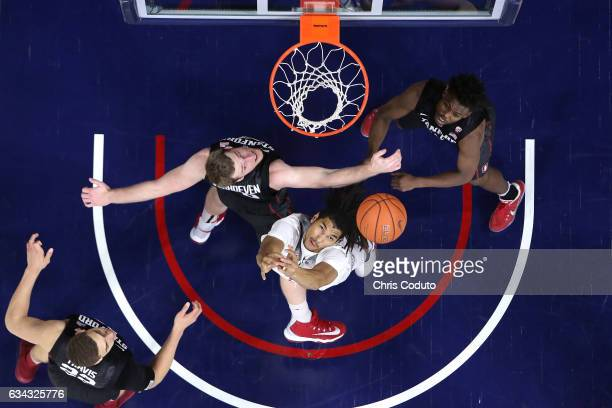 Keanu Pinder of the Arizona Wildcats fights for a rebound with Grant Verhoeven and Marcus Allen of the Stanford Cardinal during the first half of the...