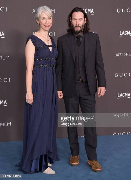 Keanu Reeves and Alexandra Grant arrive at the 2019 LACMA Art Film Gala Presented By Gucci on November 2 2019 in Los Angeles California