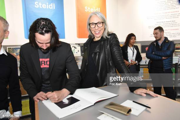 Keanu Reeves and Alexandra Grant attend the Shadow Book signing on Steidle stand as part of Paris Photo 2017 Day Two At Le Grand Palais on November...