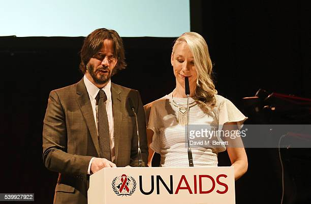 Keanu Reeves and Alexandra Grant speak at the UNAIDS Gala during Art Basel 2016 at Design Miami/ Basel on June 13 2016 in Basel Switzerland