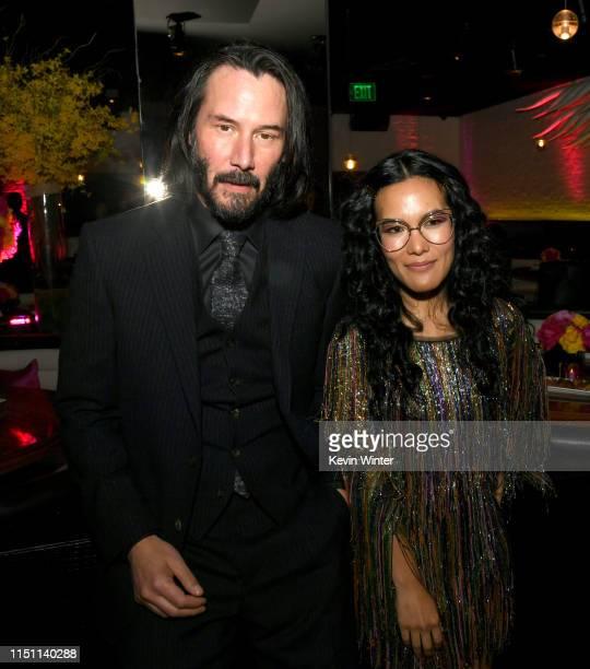 Keanu Reeves and Ali Wong pose at the after party for the premiere of Netflix's Always Be My Maybe at STK on May 22 2019 in Westwood California