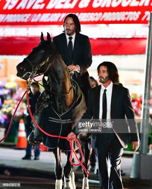 Keanu Reeves and his stunt double seen with a horse on location for 'John Wick 3' in Brooklyn on July 14 2018 in New York City