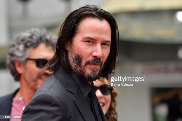 Keanu Reeves arrives for his handprint ceremony at the TCL Chinese Theatre IMAX forecourt on May 14 2019 in Hollywood California