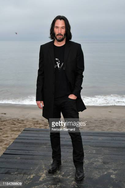 Keanu Reeves attends the Saint Laurent Mens Spring Summer 20 Show on June 06 2019 in Paradise Cove Malibu California
