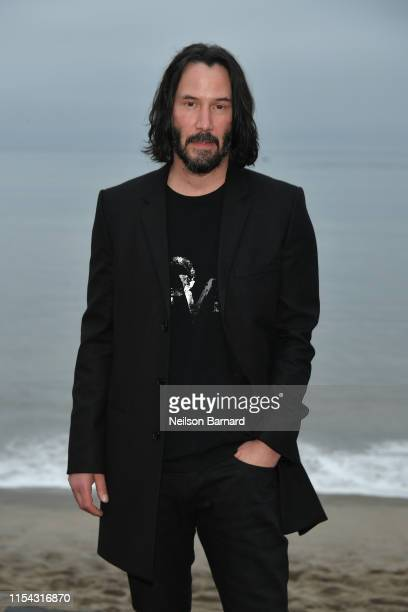 Keanu Reeves attends the Saint Laurent Mens Spring Summer 20 Show Photo Call on June 06 2019 in Malibu California