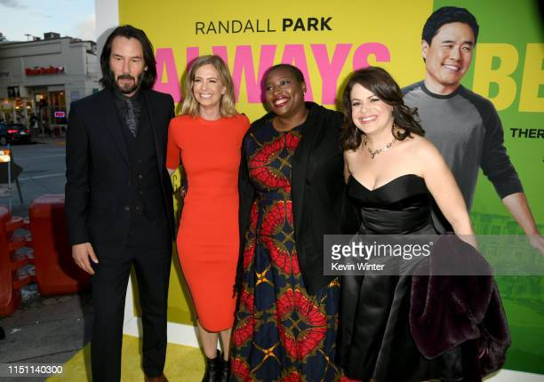 Keanu Reeves Erin Westerman Tahirah Gooden and Racheline Benveniste pose at the premiere of Netflix's Always Be My Maybe at the Regency Village...