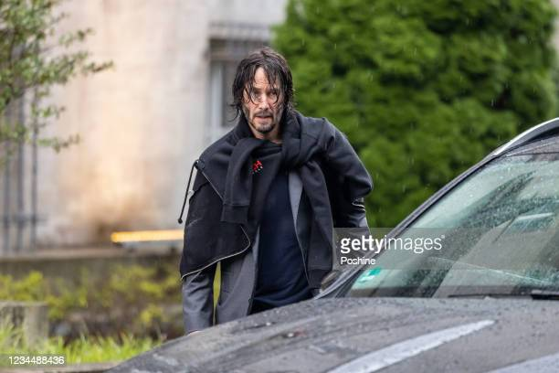 """Keanu Reeves is seen leaving his hotel to go to the set of """"John Wick: Chapter 4"""" on August 5, 2021 in Berlin, Germany."""