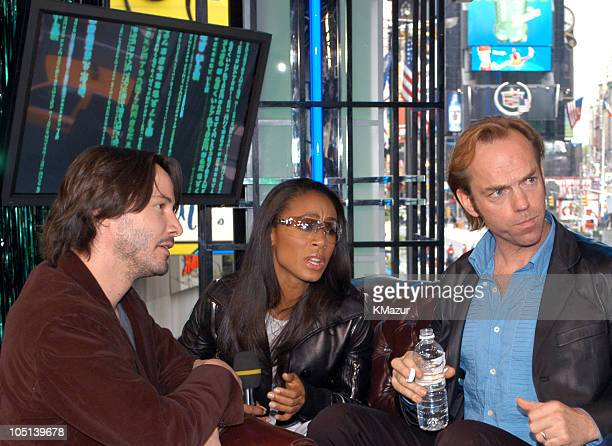 Keanu Reeves Jada Pinkett Smith and Hugo Weaving during The Cast of The Matrix Reloaded and POD Visit MTV's TRL May 5 2003 at MTV Studios Times...