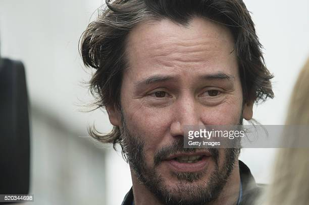 Keanu Reeves of Canada speaks with journalist in paddock during the MotoGp Red Bull US Grand Prix of The Americas Race at Circuit of The Americas on...