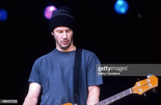 Keanu Reeves performs on stage with his band Dogstar, Glastonbury Festival, United Kingdom, 1994.