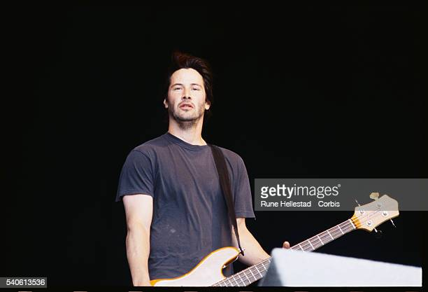 Keanu Reeves performs with his band Dogstar at the Glastonbury Festival.