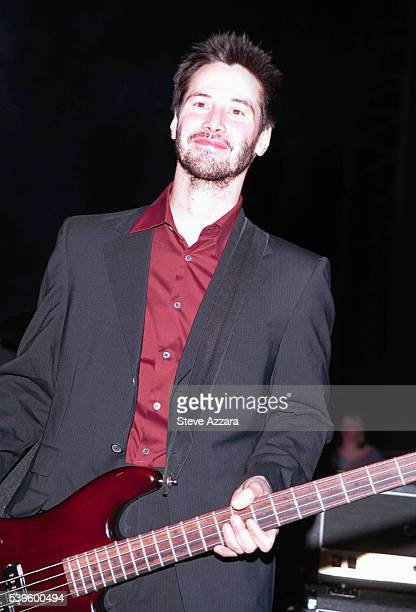 Keanu Reeves plays bass guitar with his band Dogstar at a party hosted by Mademoiselle Magazine and DKNY Jeans.
