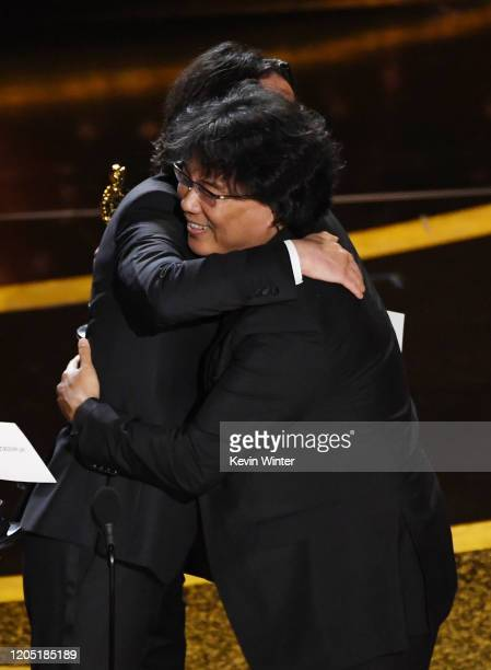 Keanu Reeves presents the Writing Original Screenplay award for 'Parasite' award to Bong Joonho onstage during the 92nd Annual Academy Awards at...