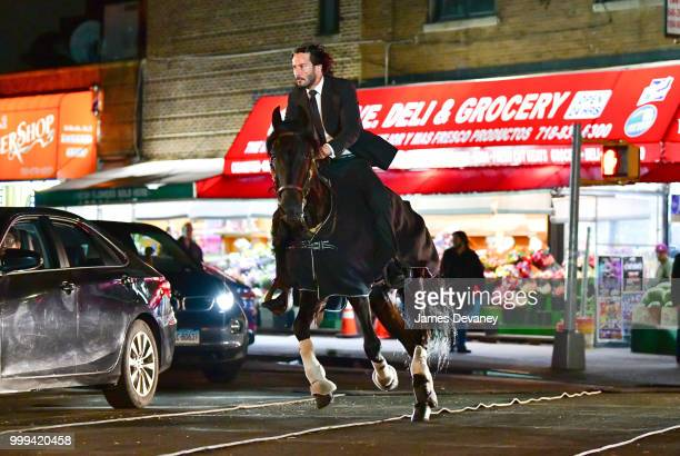 Keanu Reeves seen riding a horse on location for 'John Wick 3' in Brooklyn on July 14 2018 in New York City