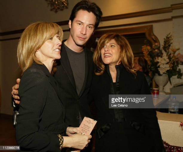 Keanu Reeves with director Nancy Meyers and Columbia Chairman Amy Paschal