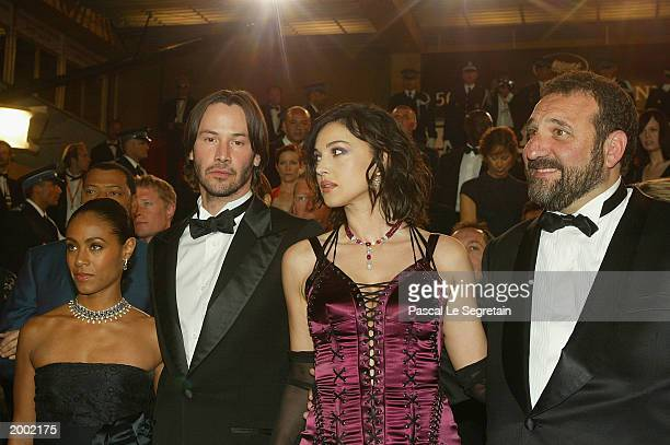 Keanu Reeves with Jada PinkettSmith and Monica Bellucci leave the screening of the film Matrix Reloaded at the Palais des Festivals during the 56th...