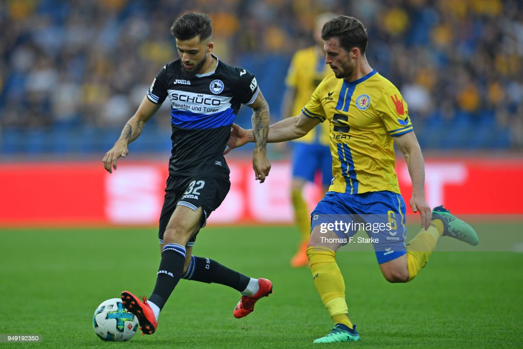 Keanu Staude (L) of Bielefeld and Quirin Moll of Braunschweig fight for the ball during the Second Bundesliga match between Eintracht Braunschweig and DSC Arminia Bielefeld at Eintracht Stadion on April 20, 2018 in Braunschweig, Germany.