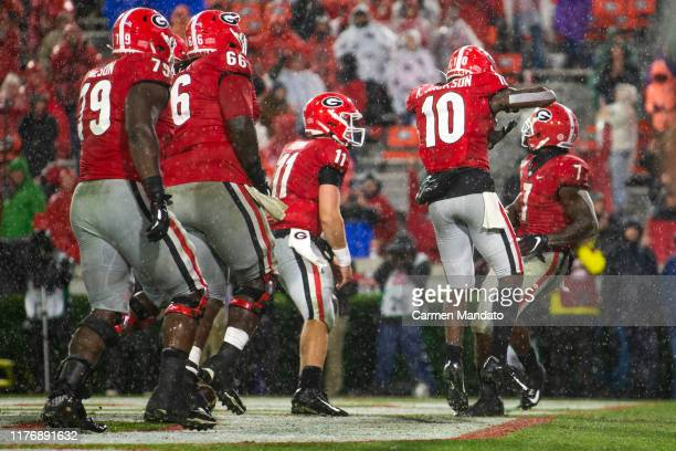 Kearis Jackson and Jake Fromm celebrate D'Andre Swift of the Georgia Bulldogs rushing for a touchdown during the second half of a game against the...