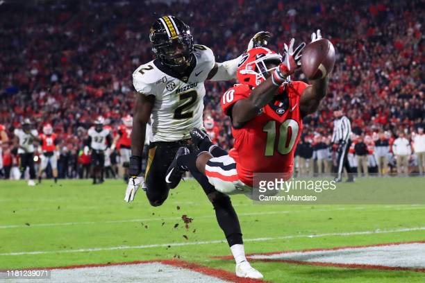Kearis Jackson of the Georgia Bulldogs is unable to make a reception in front of defender DeMarkus Acy of the Missouri Tigers during the first half...