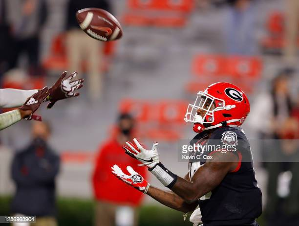 Kearis Jackson of the Georgia Bulldogs pulls in this touchdown reception against Shawn Preston Jr. #12 of the Mississippi State Bulldogs during the...