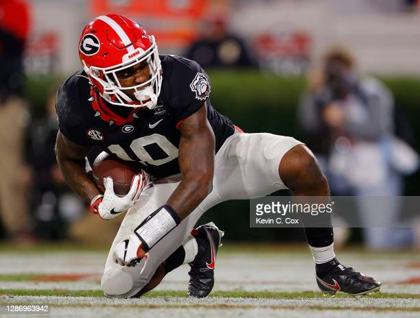 Kearis Jackson of the Georgia Bulldogs reacts after pulling in this touchdown reception against Shawn Preston Jr. #12 of the Mississippi State...