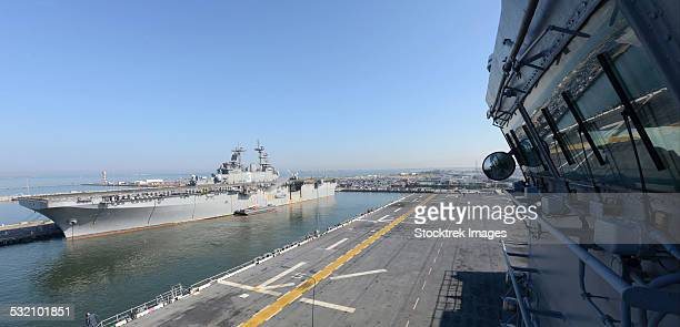 uss kearsarge and uss bataan moored. - moored stock pictures, royalty-free photos & images
