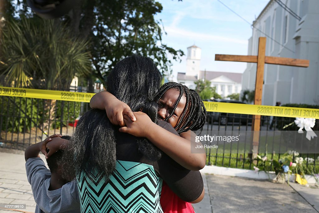 Kearston Farr comforts her daughter, Taliyah Farr,5, as they stand in front of the Emanuel African Methodist Episcopal Church after a mass shooting at the church that killed nine people of June 19, 2015. A 21-year-old white gunman is suspected of killing nine people during a prayer meeting in the church, which is one of the nation's oldest black churches in Charleston.