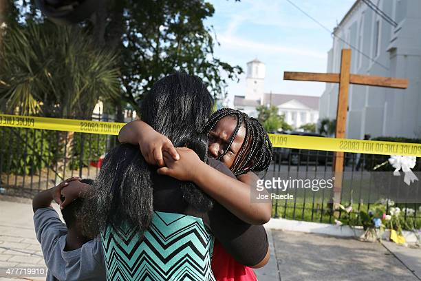 Kearston Farr comforts her daughter Taliyah Farr as they stand in front of the Emanuel African Methodist Episcopal Church after a mass shooting at...